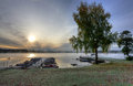Swedish lake boat harbor in autumn season idyllic foggy landscape of Stock Image