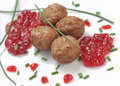 Swedish meatballs with berries jam and fresh chive on white background Royalty Free Stock Photo