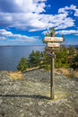 Swedish wooden signs on the rocky coast beautiful natural sea landscape in spring season Royalty Free Stock Images
