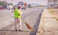 Sweeper cleaning the road with broom Royalty Free Stock Photo