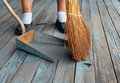 Sweeping with Broom Into Dustpan Stock Image