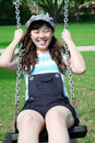 Sweet Asian girl on a swing Royalty Free Stock Image