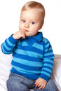 Sweet baby boy in blue cardigan Stock Photos
