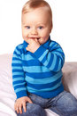 Sweet baby boy in blue cardigan Royalty Free Stock Image