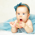 Sweet baby girl with lollipop happy birthday card Royalty Free Stock Images
