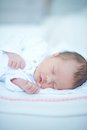Sweet baby girl sleeping on white blanket Stock Photography