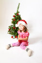 Sweet Baby with a red ball and Christmas tree Royalty Free Stock Photography