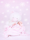 Sweet baby sleep in own pink bedroom with great white teddy bear cute interior for child with flower print on the wall happy Stock Photography