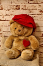 Sweet bear with a heart and a cap teddy Stock Photo