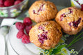 Sweet berry breakfast three cupcakes with raspberry and cereal on the plate Stock Image