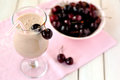 Sweet black cherry smoothie in a glass Royalty Free Stock Image