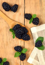 Sweet blackberry on wooden table Stock Photo
