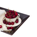 Sweet bowl on tray ripe of red cherry in isolated white background Royalty Free Stock Images