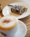 Sweet breakfast close up coffe cup with capuchino and cake in street cafe Stock Image