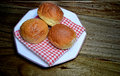 Sweet buns treat or donuts on wood texture Stock Image