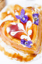 Sweet cake with caramel glaze and violet Royalty Free Stock Images