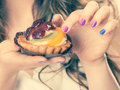Sweet cake cupcake on woman hand Royalty Free Stock Photo