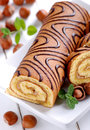 Sweet cake roll with hazelnuts cream Royalty Free Stock Images