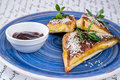 Sweet cakes triangular shape with sesame seeds and jam