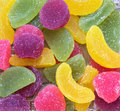 Sweet candy marmalade in the form of fruit slices. Multicolored jelly candies. Royalty Free Stock Photo