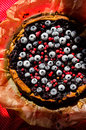 Sweet cheese cake with licorice and fruits Royalty Free Stock Photo