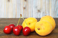 Sweet cherries and apricots Royalty Free Stock Photo