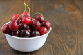 Sweet cherries in bowl on wooden background. Royalty Free Stock Photo