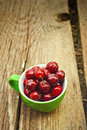 Sweet cherry in a bowl on the grass ripe fruit also known as wild bird or gean Stock Image