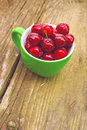 Sweet cherry in a bowl on the grass ripe fruit also known as wild bird or gean Stock Images