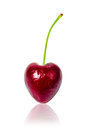 Sweet cherry heart shape isolated on white. Royalty Free Stock Photo