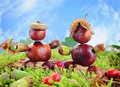 Sweet chestnut figurines autumn decoration for children made of chestnuts Stock Images