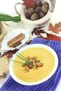 Sweet chestnut soup a bowl of with roasted chestnuts and chives Royalty Free Stock Images