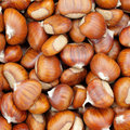 Sweet chestnuts - marron - as background Stock Images
