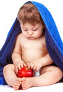 Sweet child with red apple discovering fresh isolated on white background enjoying ripe fruit baby after bathing healthy kids food Royalty Free Stock Images