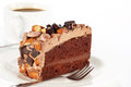 Sweet chocolate cake topping almond nut with coffee and Royalty Free Stock Photos
