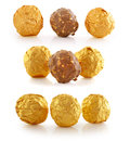 Sweet chocolate candy wrapped in golden foil Royalty Free Stock Photo