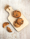 Sweet chocolate cookies top view on the small board Royalty Free Stock Photo