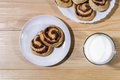 Sweet cinnamon rolls with milk Royalty Free Stock Photo