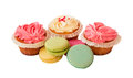 Sweet colorful macaroons and cupcakes isolated on white. Selective focus