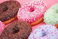 Sweet colorful tasty donuts on pink background.