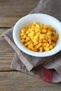 Sweet corn in a white bowl food on wooden background Stock Image