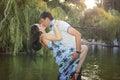 Sweet couple kissing near river walking photo taken in Stock Images