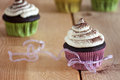 Sweet cupcakes with a ribbon Stock Image