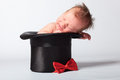 Sweet cute baby in the silk hat Royalty Free Stock Photo