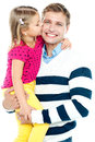 Sweet daughter kissing her smiling father Royalty Free Stock Photo