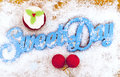 Sweet day letters and one cupcake on a table with christmas decoration Stock Images
