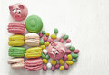 Sweet delicate macaroon pink macaroons , marshmallows, peanuts in sugar pastel colours on a light background with place Royalty Free Stock Photo
