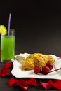 Sweet dessert croissant and a juice Royalty Free Stock Image