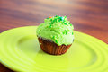 Sweet dessert with green cream on plate Stock Photography