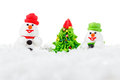 Sweet dessert snowman, snow and Christmas tree with festive decoration Royalty Free Stock Photo
